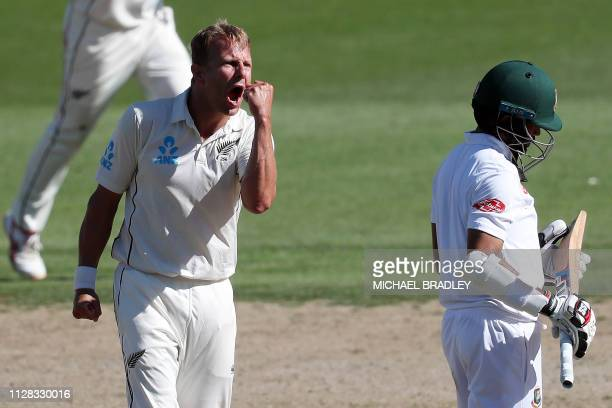 New Zealand's Neil Wagner celebrates the wicket of Shadman Islam of Bangladesh during day three of the first cricket Test match between New Zealand...