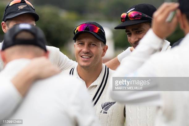 New Zealand's Neil Wagner huddles with teammates during day five of the second cricket Test match between New Zealand and Bangladesh at the Basin...