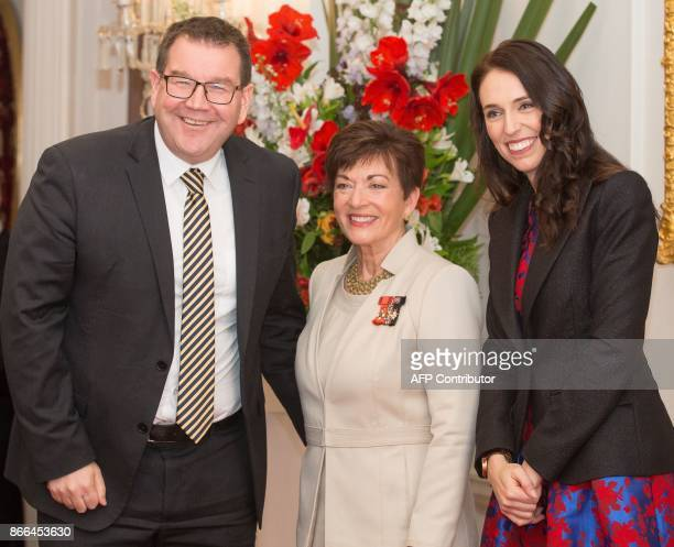 New Zealand's new Minster of Finance Grant Robertson poses with New Zealand's Prime Minister Jacinda Ardern and GovernorGeneral Dame Patsy Reddy in...
