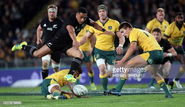 New Zealand's Ngani Laumape and Australia's Jack Maddocks compete for the loose ball during the second rugby Test match between New Zealand and...