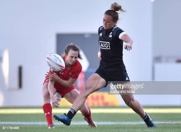 New Zealand's Niall Williams kicks the ball past a Canadian player during the final at the World Rugby Women's Sevens Series in Kitakyushu Fukuoka...