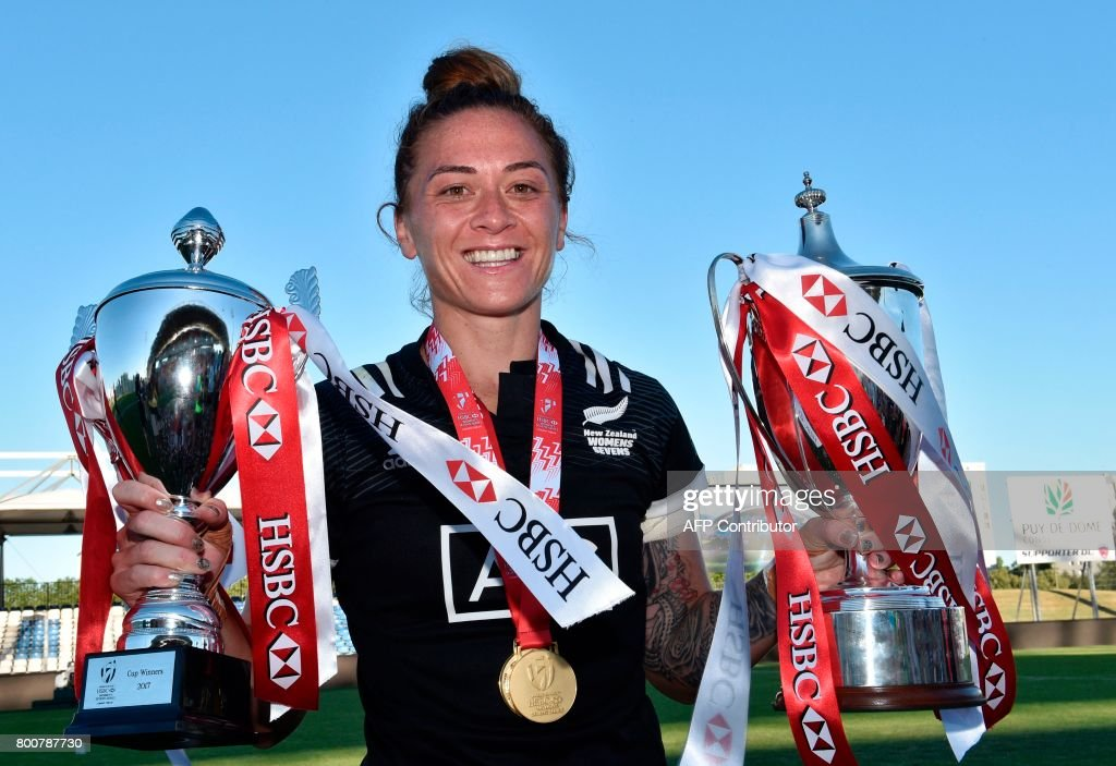 New Zealand's Niall Williams poses with a pair of trophies and her winners medal as she celebrates after her team's victory in the women's rugby seven's World series final match between Australia and New Zealand at The Montpied Stadium in Clermont-Ferrand on June 25, 2017. / AFP PHOTO / Thierry Zoccolan