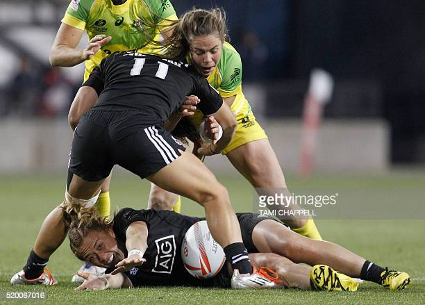 New Zealand's Niall Williams tries to hold onto the ball as teammate Portia Woodman blocks against Australia's Chloe Dalton at the final of the...