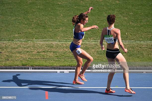 New Zealand's Nikki Hamblin helps USA's Abbey D'agostino after she was injured in the Women's 5000m Round 1 during the athletics event at the Rio...