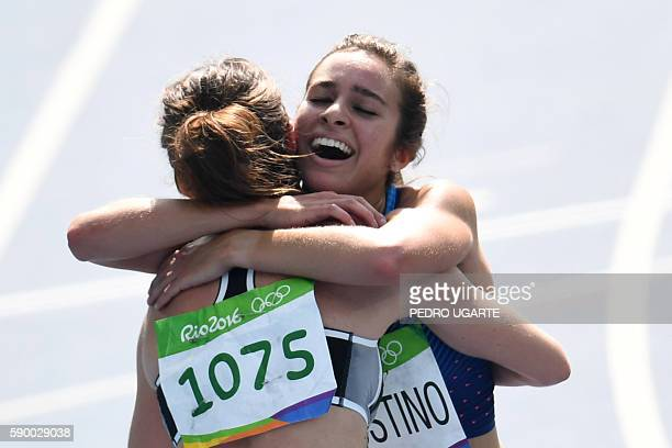 New Zealand's Nikki Hamblin hugs USA's Abbey D'agostino after they competed in the Women's 5000m Round 1 during the athletics event at the Rio 2016...