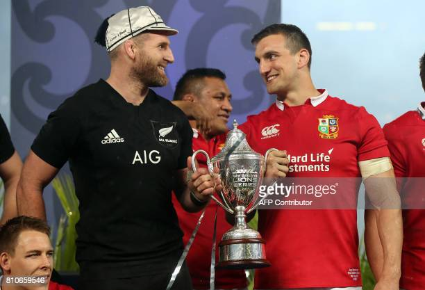 New Zealand's No 8 Kieran Read and British and Irish Lions blindside flanker Sam Warburton hold the trophy after the drawn test series following the...