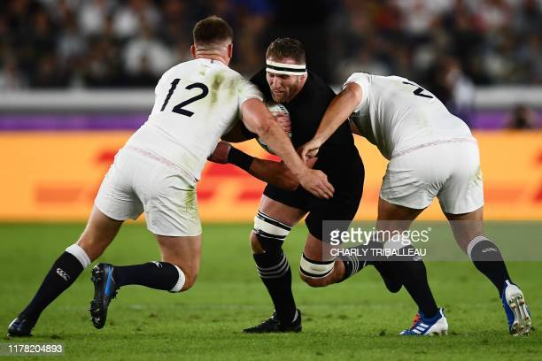 TOPSHOT New Zealand's number 8 Kieran Read is tackled by England's centre Owen Farrell and England's hooker Jamie George during the Japan 2019 Rugby...