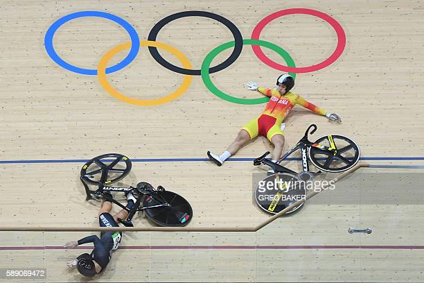 TOPSHOT New Zealand's Olivia Podmore and Spain's Tania Calvo Barbero fall during the women's Keirin first round track cycling event at the Velodrome...