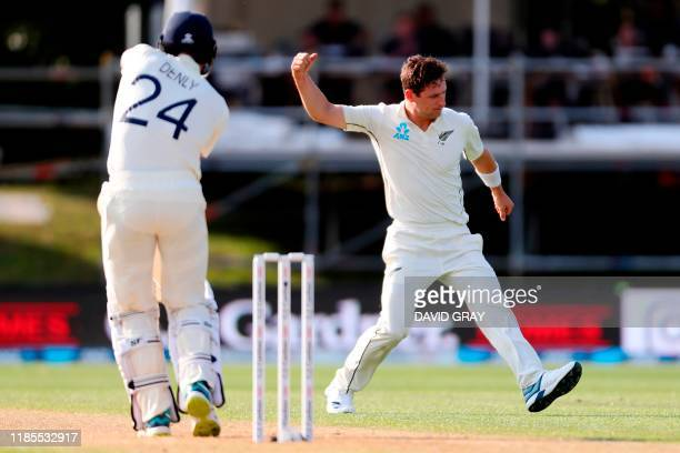 New Zealand's paceman Matt Henry celebrates his wicket of England's batsman Joe Denly on day two of the second cricket Test match between England and...