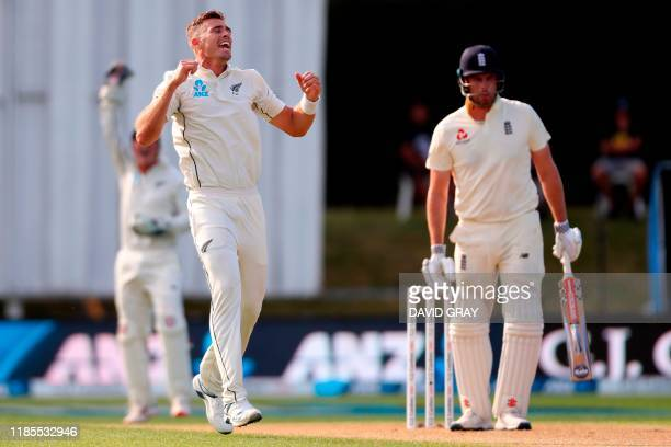 New Zealand's paceman Tim Southee celebrates his wicket of England's batsman Dom Sibley on day two of the second cricket Test match between England...