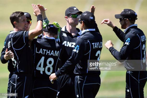 New Zealand's paceman Trent Boult celebrates his wicket of Bangladesh's Tamim Iqbal with teammates during the first oneday international cricket...
