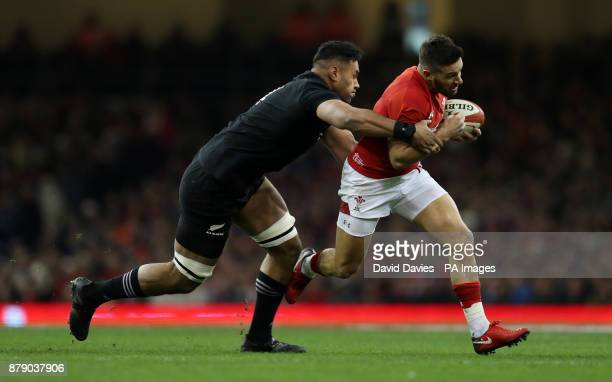 New Zealand's Patrick Tuipulotu tackles Wales' Rhys Webb during the Autumn International at the Principality Stadium Cardiff