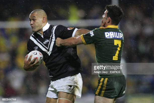 New Zealand's Paul Rauhihi hands off Australia Craig Gower in the face