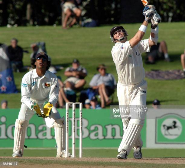 New Zealand's Paul Wiseman and Sri Lankan wicket keeper Kumar Sangakkara follow the flight of the ball after Wiseman skied it on the second day in...