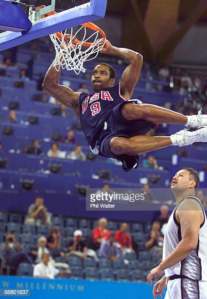 New Zealand's Peter Pokai watches in awe as USA's Vince Carter slams the ball in their Mens Basketball match at the 2000 Sydney Olympics SaturdayUSA...