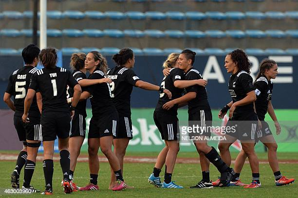 New Zealand's players celebrate after winning the IRB Women's Sevens World Series final match against Australia in Barueri, some 30 km from Sao...