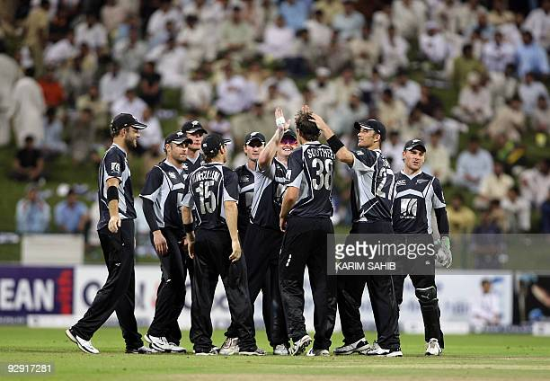 New Zealand's players celebrate during their third oneday international cricket match against Pakistan in Abu Dhabi on November 9 2009 New Zealand...