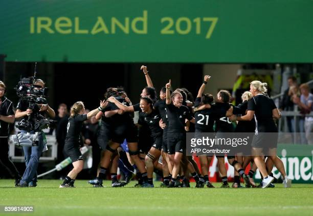 New Zealand's players celebrate on the pitch at the final whistle of the Women's Rugby World Cup 2017 final match between England and New Zealand at...