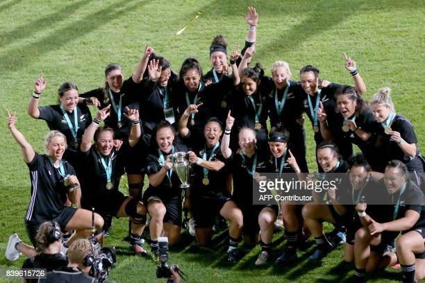 New Zealand's players celebrate their victory on the pitch after the Women's Rugby World Cup 2017 final match between England and New Zealand at The...