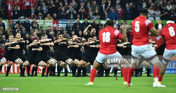 New Zealand's players perform the haka and Tonga's perform the Sipi Tau prior to a Pool C match of the 2015 Rugby World Cup between New Zealand and...