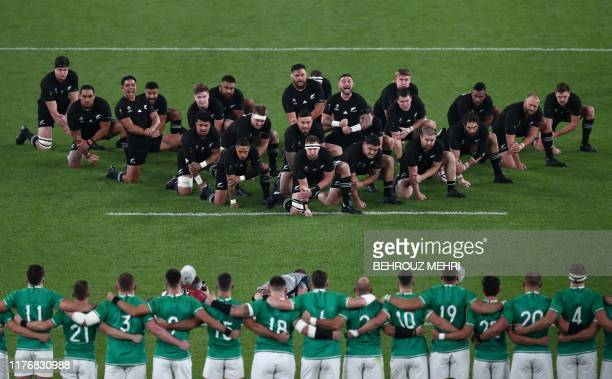 New Zealand's players perform the haka as Ireland's line up before the Japan 2019 Rugby World Cup quarterfinal match between New Zealand and Ireland...
