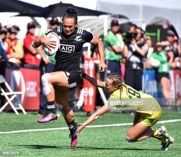 New Zealand's Portia Woodman avoids being tackled by Australia's Emma Sykes and scores a try in the HSBC Canada Women's Rugby Sevens in Langford,...