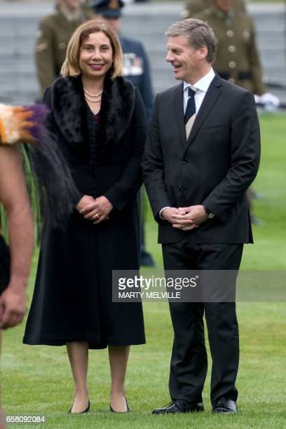 New Zealand's Prime Minister Bill English and his wife Mary wait for China's Premier Li to arrive during a welcome ceremony at Government House in...