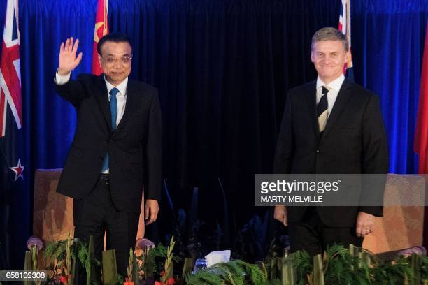 New Zealand's Prime Minister Bill English arrives at a joint press conference with China's Premier Li Keqiang in Wellington on March 27 2017 Li is on...