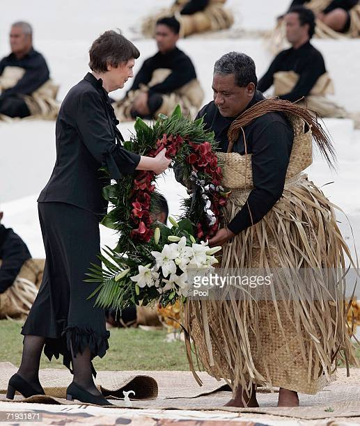 New Zealand's Prime Minister Helen Clark delivers a wreath to the royal undertaker for the tomb of the late King Taufa'ahau Tupou IV at his state...
