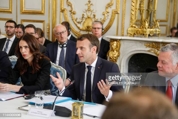 New Zealand's Prime Minister Jacinda Ardern, French President Emmanuel Macron and King Abdullah II of Jordan attend a launching ceremony for the...