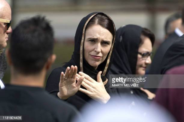 TOPSHOT New Zealand's Prime Minister Jacinda Ardern gestures as she departs following a gathering for congregational Friday prayers and two minutes...