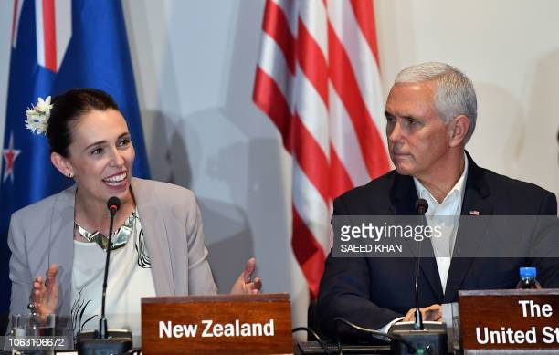 New Zealand's Prime Minister Jacinda Ardern speaks as US Vice President Mike Pence looks on at an electricity projects signing ceremony during the...