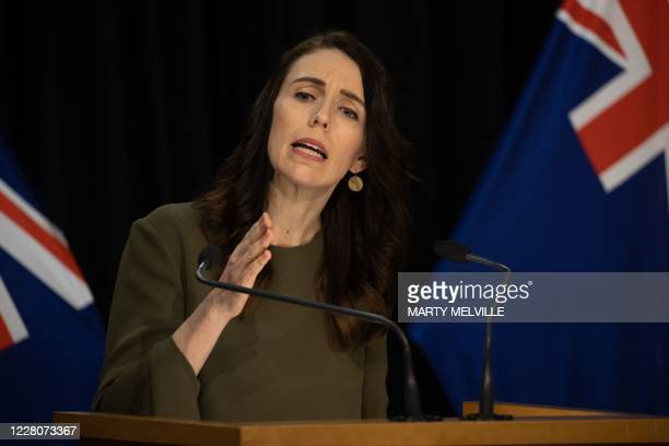 New Zealand's Prime Minister Jacinda Ardern speaks to the media about changing the 2020 general election date during a press conference at the...