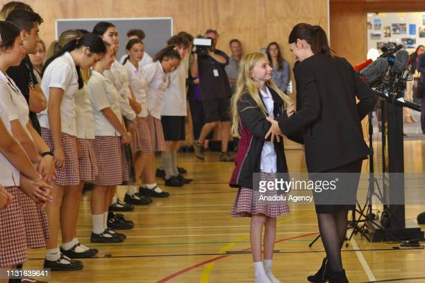 New Zealand's Prime minister Jacinda Ardern talks to a student following her speech at Cashmere high school in Christchurch New Zealand on March 20...