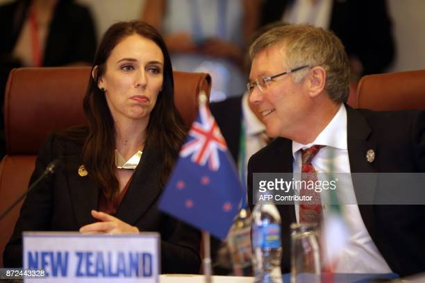 New Zealand's Prime Minister Jacinda Ardern talks with Trade and Export Growth Minister David Parker at the TransPacific Partnership meeting on the...