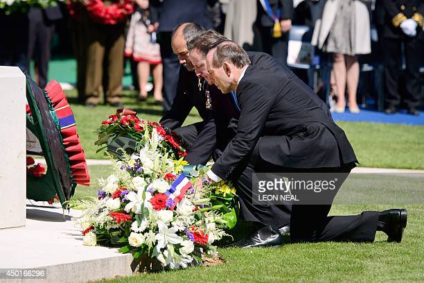 New Zealand's Prime Minister John Key British Prime Minister David Cameron and Australia's Prime Minister Tony Abbott lay wreaths during a British...