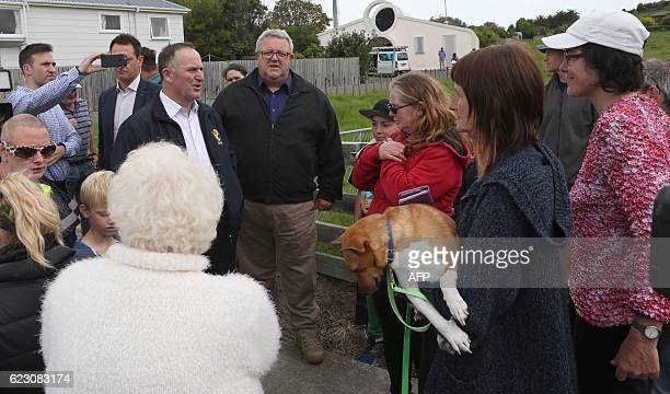 New Zealand's Prime Minister John Key speaks to locals in Kaikoura on the South Island's east coast on November 14 2016 A powerful 78magnitude...