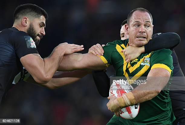 New Zealand's prop and captain Jesse Bromwich tackles Australia's prop Matthew Scott during the rugby league Four Nations Final match between...