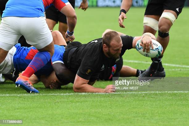 New Zealand's prop Joe Moody scores a try during the Japan 2019 Rugby World Cup Pool B match between New Zealand and Namibia at the Tokyo Stadium in...