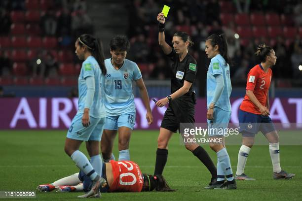 New Zealand's referee AnnaMarie Keighley shows a yellow card to Chile's forward Yessenia Huenteo after a foul on Chile's forward Daniela Zamora...