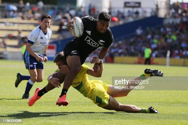 New Zealands Regan Ware dives in for a try during the men's rugby semi-final match between New Zealand and Australia on day two of the World Rugby...