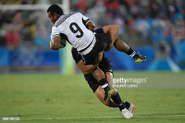 TOPSHOT New Zealand's Rieko Ioane tackles Fiji's Jerry Tuwai in the mens rugby sevens quarterfinal match between Fiji and New Zealand during the Rio...