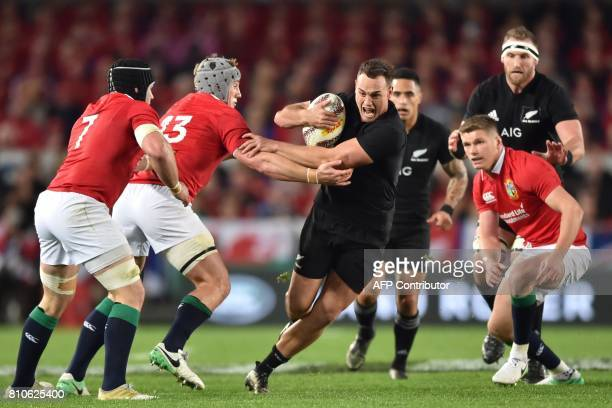 TOPSHOT New Zealand's right wing Israel Dagg is tackled by British and Irish Lions players Jonathan Davies Sean OBrien and Owen Farrell during the...