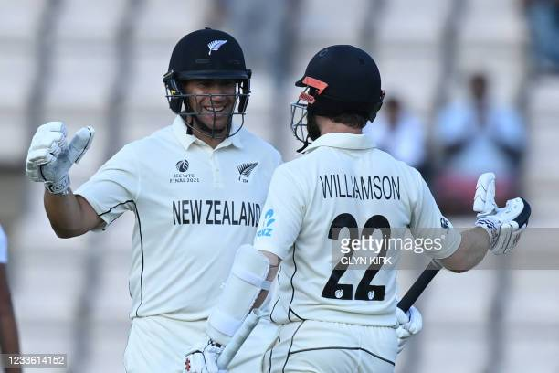 New Zealand's Ross Taylor and New Zealand's captain Kane Williamson celebrate victory on the final day of the ICC World Test Championship Final...