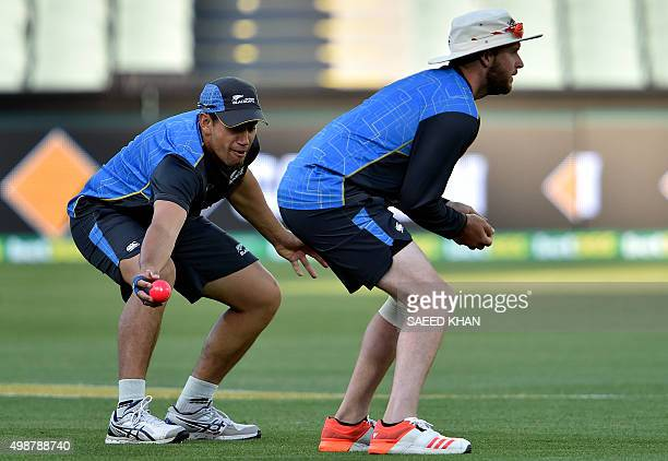 New Zealand's Ross Taylor catches a ball alongside teammate Mark Craig during a team training session at the Adelaide Oval ahead of the first...