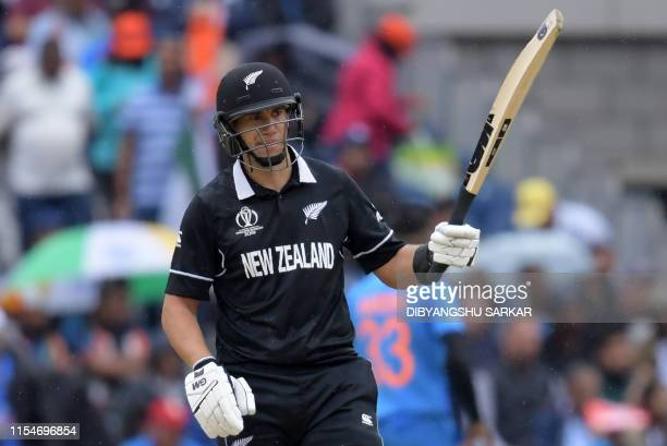New Zealand's Ross Taylor celebrates after scoring a half-century during the 2019 Cricket World Cup first semi-final between India and New Zealand at...