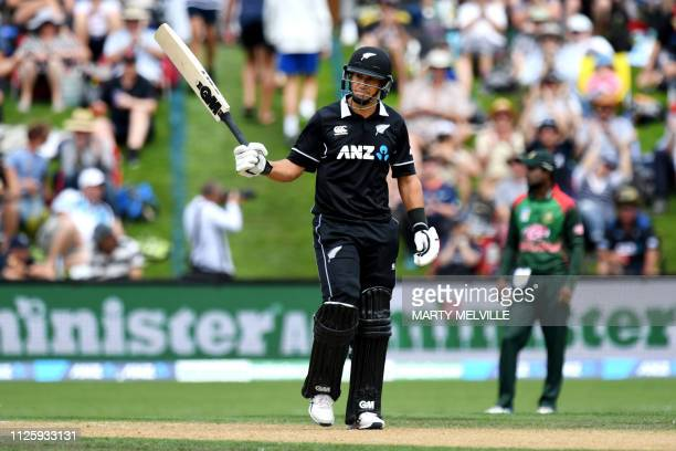 New Zealand's Ross Taylor celebrates scoring a halfcentury during the third oneday international cricket match between New Zealand and Bangladesh at...