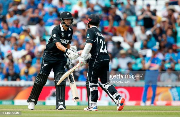 New Zealand's Ross Taylor congratulates New Zealand's Kane Williamson after he reaches 50 runs not out during the 2019 Cricket World Cup warm up...