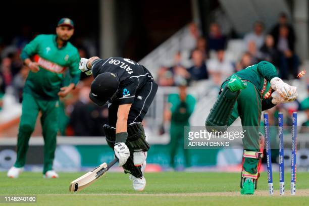 New Zealand's Ross Taylor just makes his ground as New Zealand avoid a run out during the 2019 Cricket World Cup group stage match between Bangladesh...