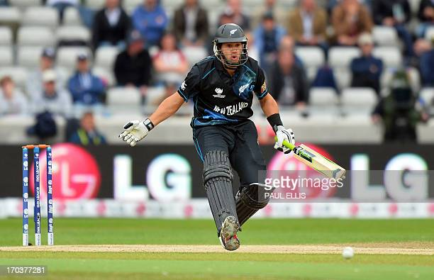 New Zealand's RossTaylor changes his mind when running during the 2013 ICC Champions Trophy cricket match between Australia and New Zealand at...
